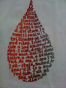 Screen printed handkerchief featuring a poem that only uses letters from the word Disaster, printed on a cotton hankie